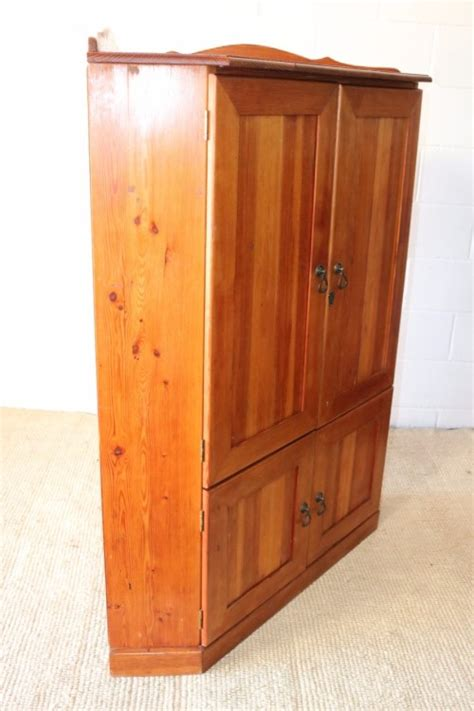 Cabinets - A solid Oregon pine corner display cabinet with